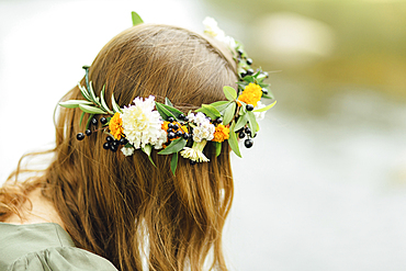Close up of Middle Eastern woman wearing flower crown