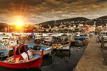 Boats at marina at sunset