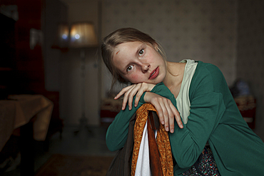 Portrait of pensive Caucasian woman leaning on chair