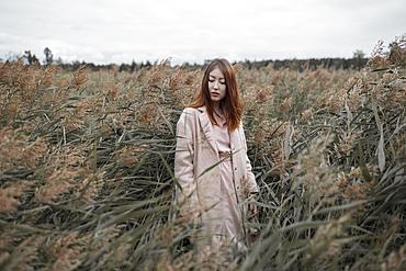 Asian woman standing in field