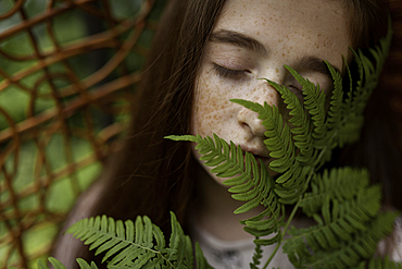 Caucasian girl smelling leaves