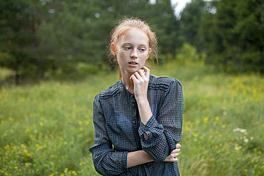 Portrait of Caucasian girl standing in field