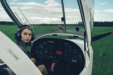 Caucasian woman sitting in airplane cockpit