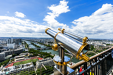 Telescope at scenic view of river in city, Paris, Ile de France, France