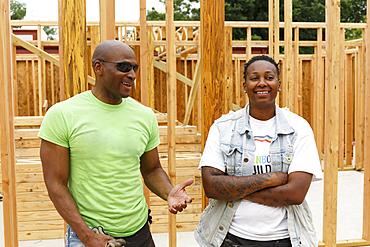 Portrait of smiling men at construction site
