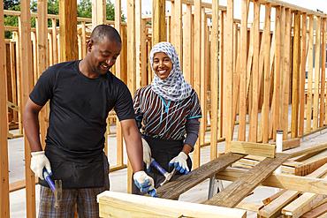 Black volunteers building house