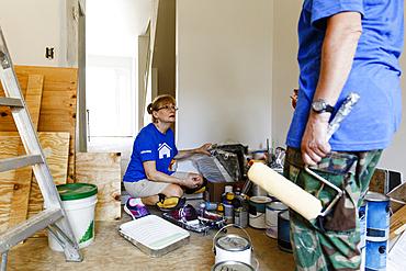 Women preparing to paint walls