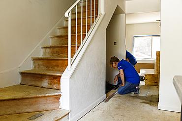 Native American woman remodeling floor