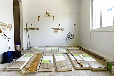 Packages of flooring on floor