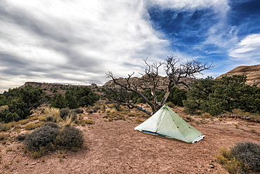 Clouds over tent in desert, Moab, Utah, United States