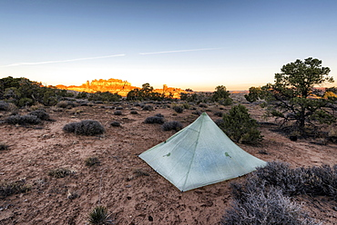 Tent in desert at sunset, Moab, Utah, United States