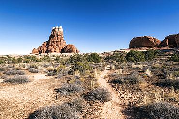 Blue sky over desert path, Moab, Utah, United States