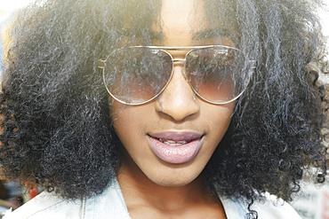 Close up of mixed race woman wearing sunglasses