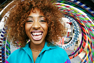 Portrait of black woman laughing near hoops