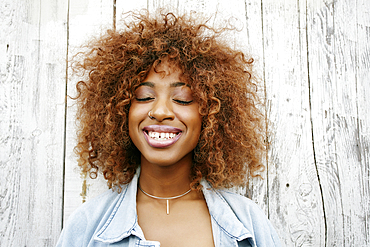 Close up of smiling black woman with eyes closed