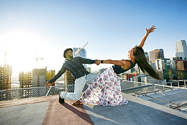 Couple dancing on urban rooftop