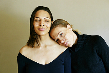 Close up of affectionate mixed race women wearing sweaters