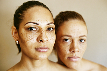 Close up of serious mixed race women