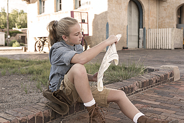Caucasian girl reading map