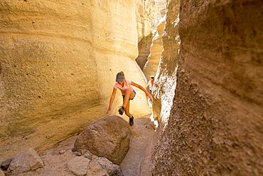 Caucasian girl climbing in canyon