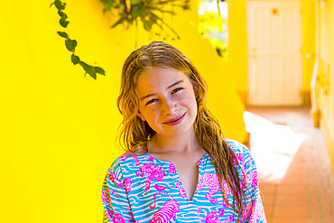 Smiling Caucasian girl with wet hair