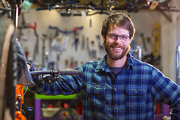 Portrait of smiling Caucasian man in bicycle shop