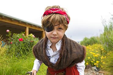 Caucasian boy wearing pirate costume