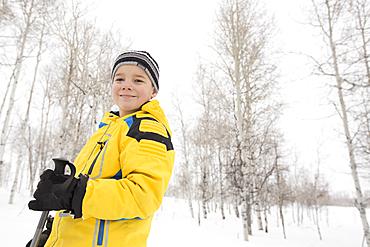 Portrait of smiling Caucasian boy in winter