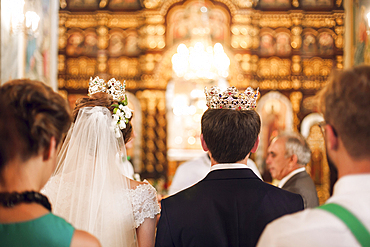 Couple wearing crowns in church