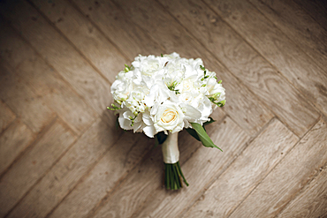 Bouquet of white roses on floor