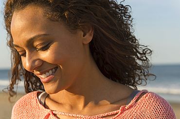 Portrait of smiling African American woman at beach