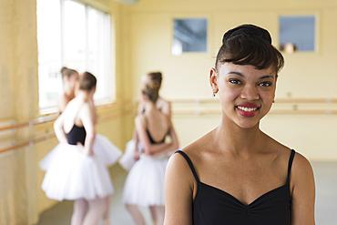 Portrait of girl smiling in ballet studio