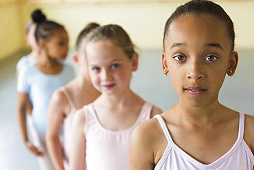 Girls standing in a row in ballet studio