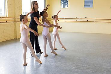 Teacher and students practicing in ballet studio