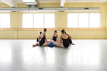 Girls sitting on floor of ballet studio