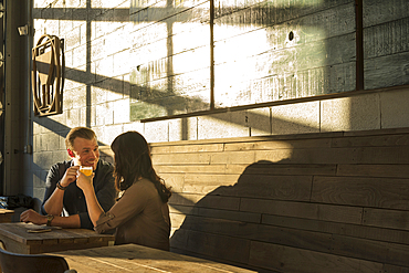 Caucasian couple talking in brew pub
