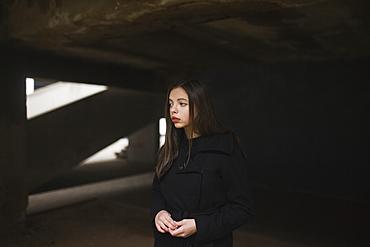 Pensive Caucasian woman wearing black coat