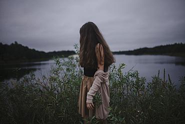 Caucasian woman standing near river