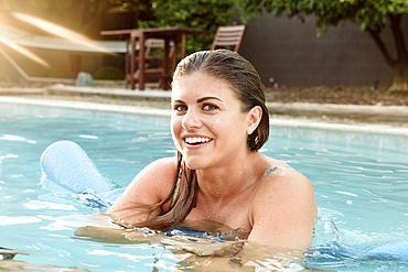 Portrait of smiling Caucasian woman in swimming pool