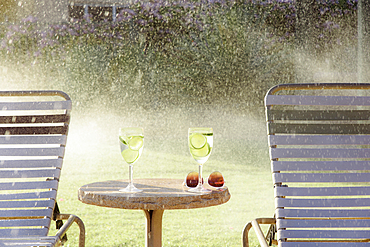 Water spraying on drinks and lounge chairs