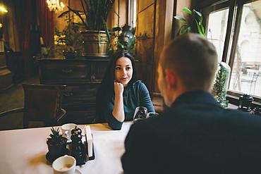 Caucasian couple drinking wine in restaurant
