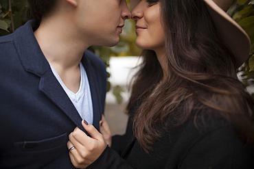 Caucasian couple rubbing noses