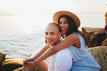 Portrait of smiling Caucasian couple at ocean