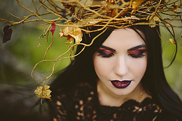Gothic Caucasian woman wearing crown of branches