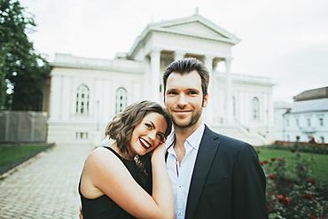 Portrait of smiling Caucasian couple hugging