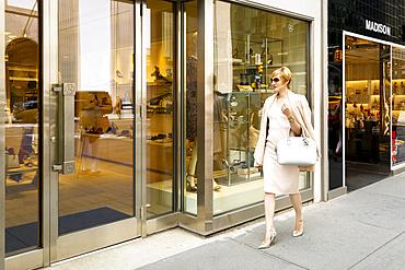 Glamorous Caucasian woman window shopping