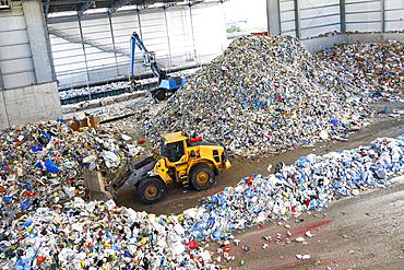 Bulldozer pushing pile of trash