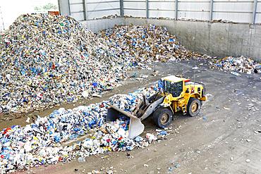 Bulldozer pushing trash