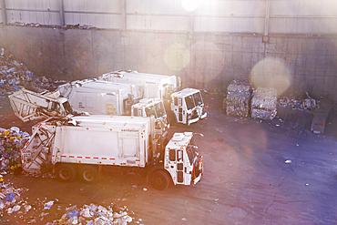 Garbage trucks unloading trash