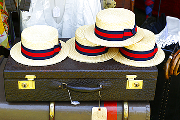 Straw hats on old-fashioned briefcase
